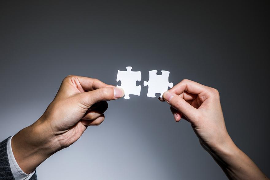 illustration av ett samlingslån där två pusselbitar sätts ihop
